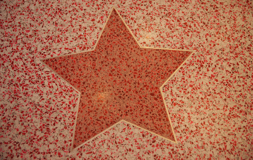 Star terrazzo graphic made with red glass terrazzo chips at American Girl in Charlotte, NC