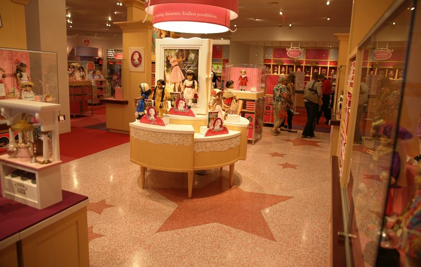 Epoxy terrazzo installation with star designs at American Girl retail store