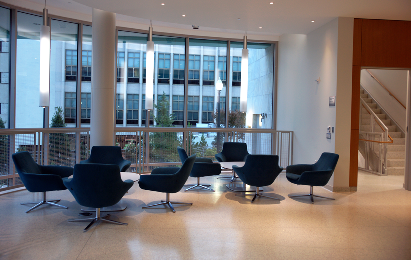 Blue cushioned chairs laying on top the epoxy terrazzo floor at American University