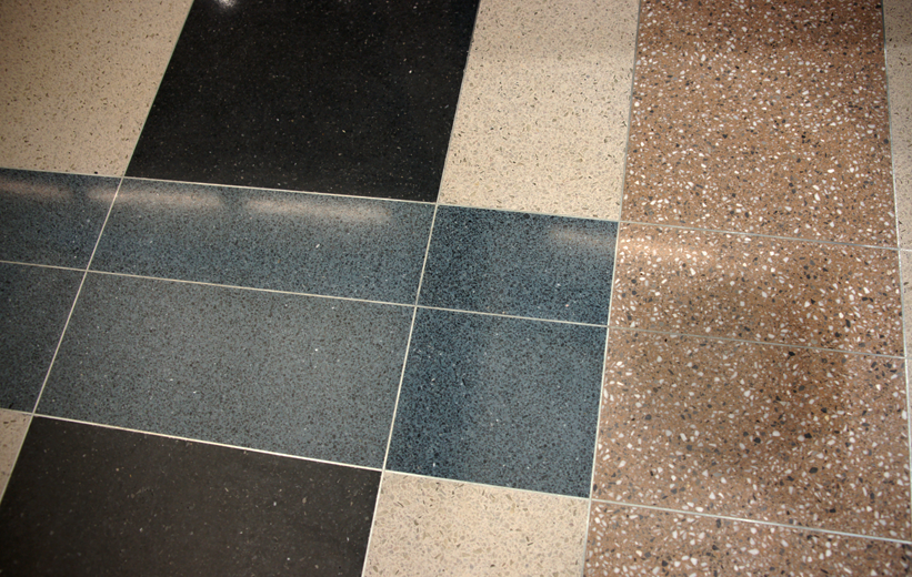 Multi-color terrazzo design with divider strips at American University
