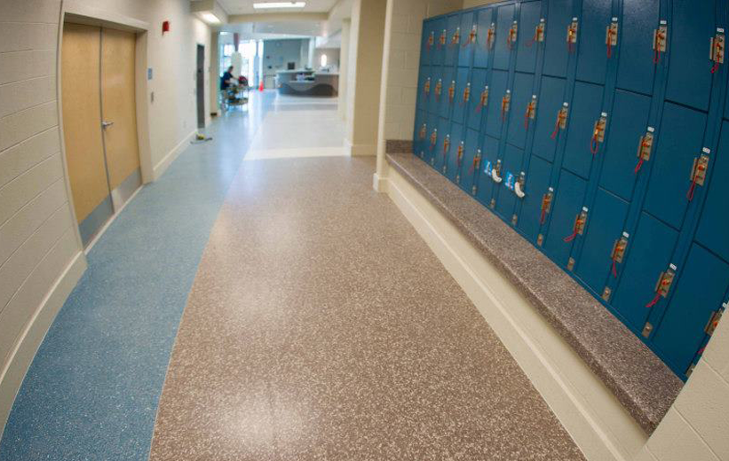 gym hallway terrazzo flooring and bench