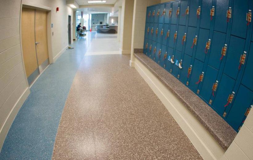gym hallway terrazzo flooring and bench