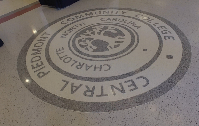 Terrazzo logo design installed at Central Piedmont Community College in Charlotte, North Carolina