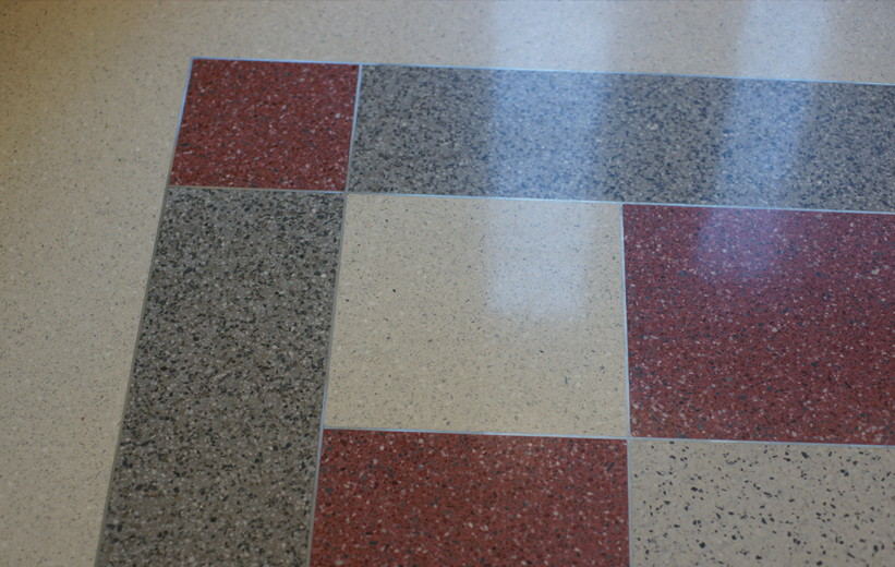 Divider strips adding geometric design to the terrazzo floors at Central Piedmont Community College