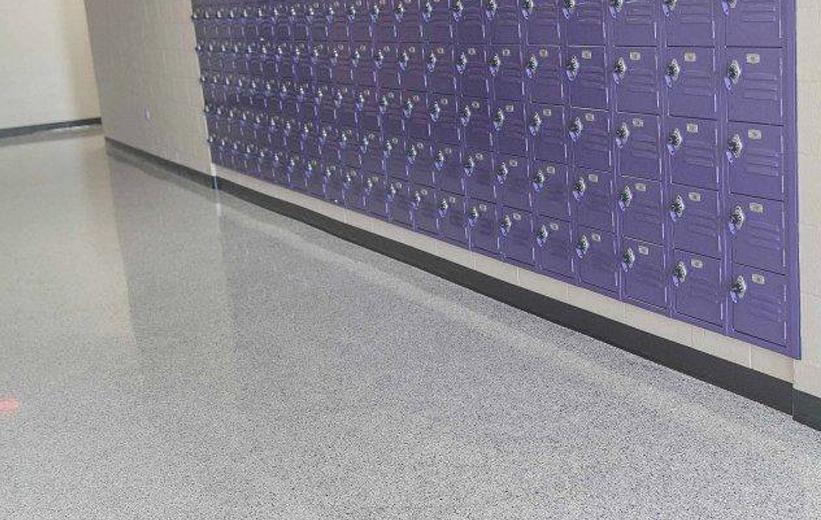 White Epoxy Terrazzo floors and purple lockers at ECU