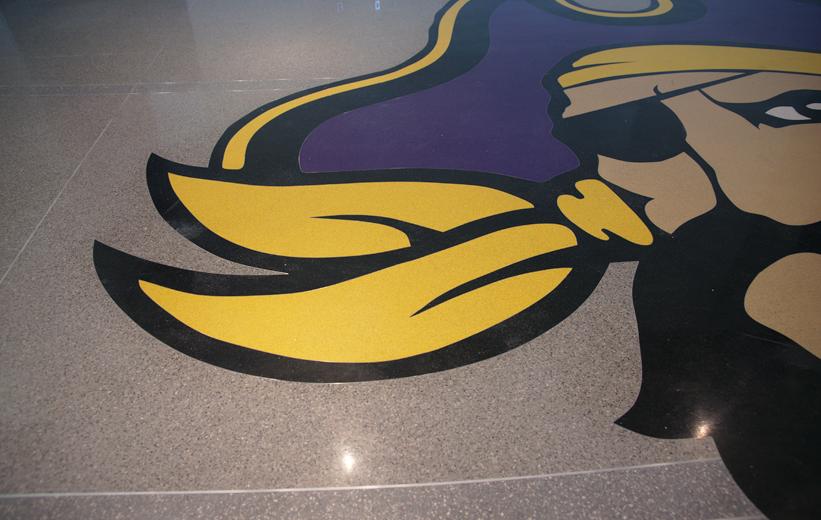 ECU Pirate terrazzo logo with yellow and purple epoxy resin