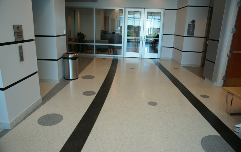 Geometric design pattern in the white and black terrazzo floor at Embry Riddle Aeronautical University