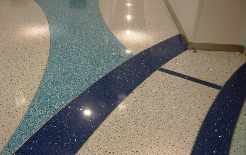 Divider strips diving colors in the terrazzo floor design at Florida Atlantic University