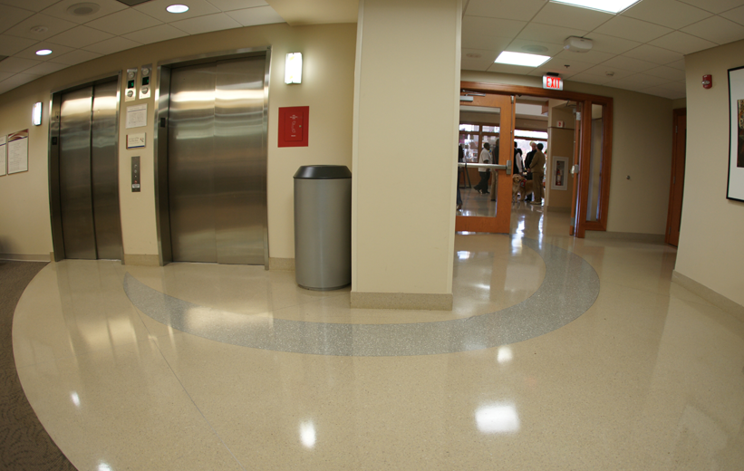 Terrazzo floor surrounding hospital lobby and elevators