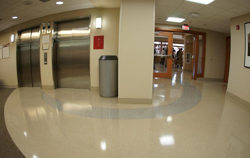 Terrazzo floor surrounding hospital lobby and elevators