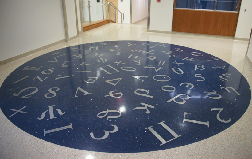 Numbers and scientific symbols in the terrazzo design at George Mason University