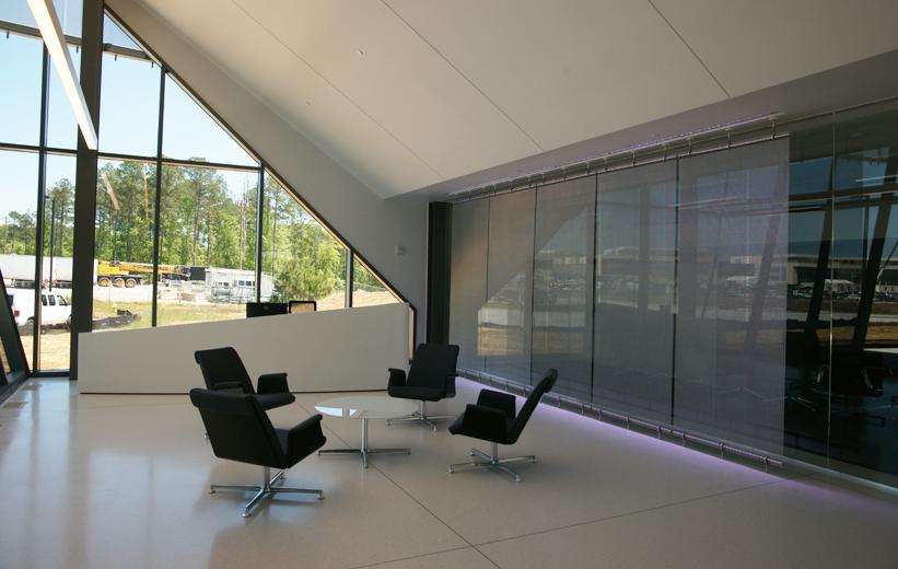 White Epoxy Terrazzo Flooring and Black Chairs Interior