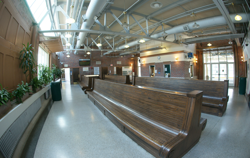 Brown benches and gray terrazzo flooring at J. Douglas Galyon Depot