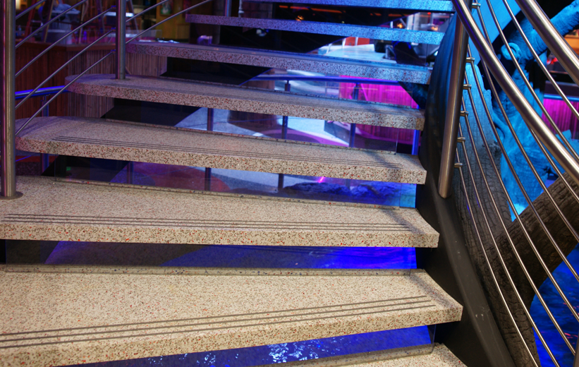 Custom terrazzo flat stair treads at Mango's Tropical Cafe in Orlando, Florida