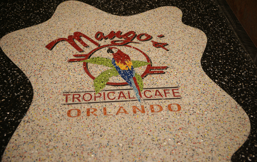 Macaw logo design made with terrazzo glass aggregates at Mango's Tropical Cafe in Orlando, Florida