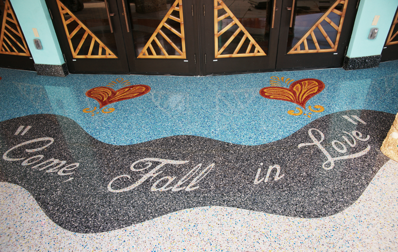 Come Fall in Love terrazzo lettering at Mango's Tropical Cafe in Orlando, Florida