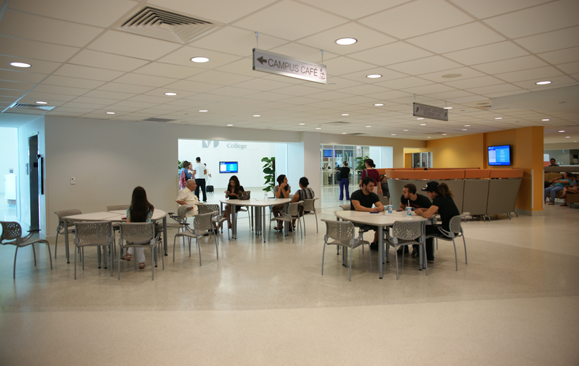 Students socializing and eating lunch at the dining area at Miami Dade College where terrazzo flooring is installed