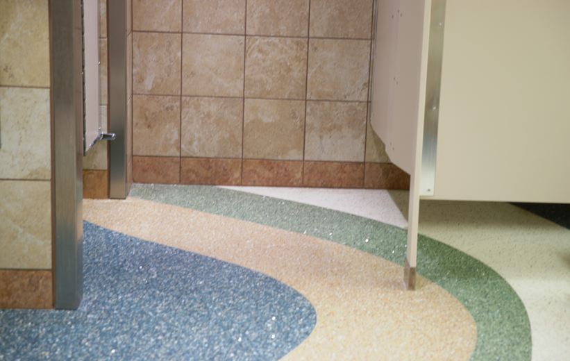 multi-color epoxy terrazzo flooring installed by bathroom stall