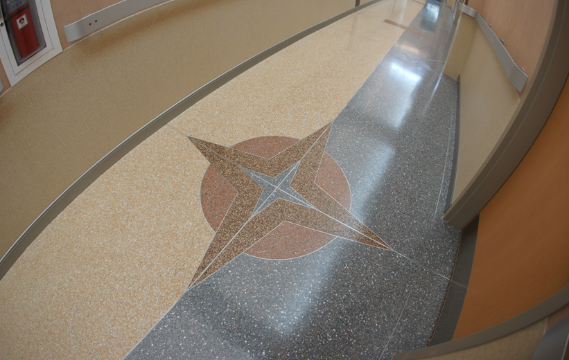 Terrazzo navigational design in Police department hallway