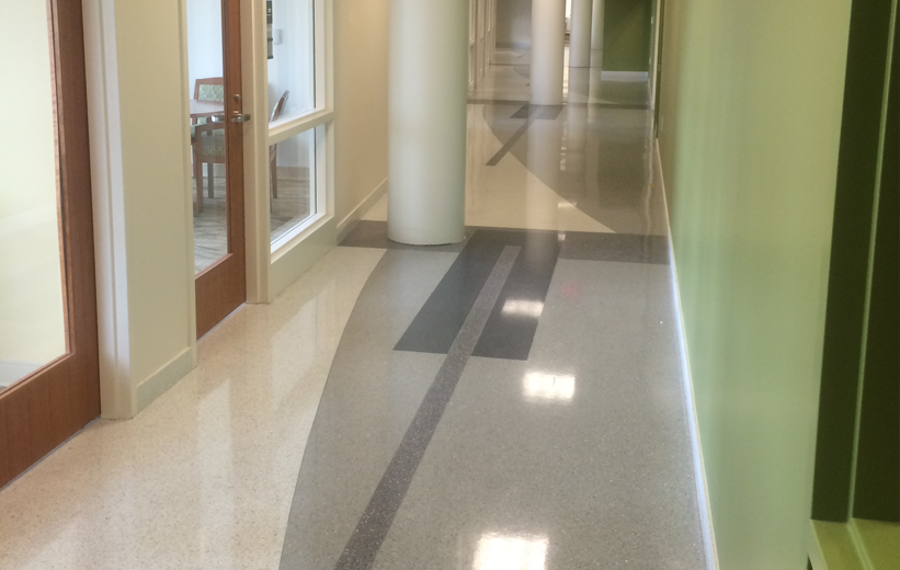 Epoxy terrazzo design with green wall at Norfolk State University