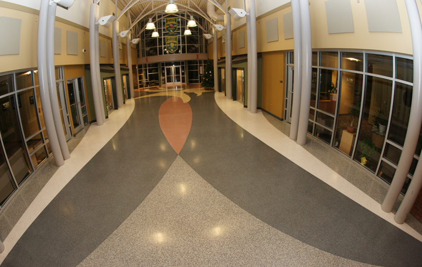 Entrance of Northside High School with custom terrazzo school logo and flooring
