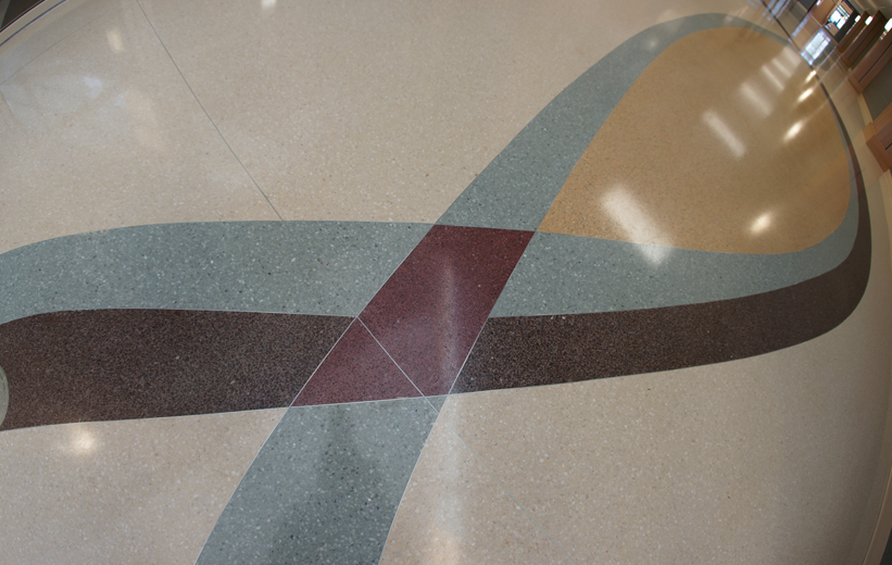 Terrazzo Floor Design at Pelion High School using burgandy, brown and green epoxy resins