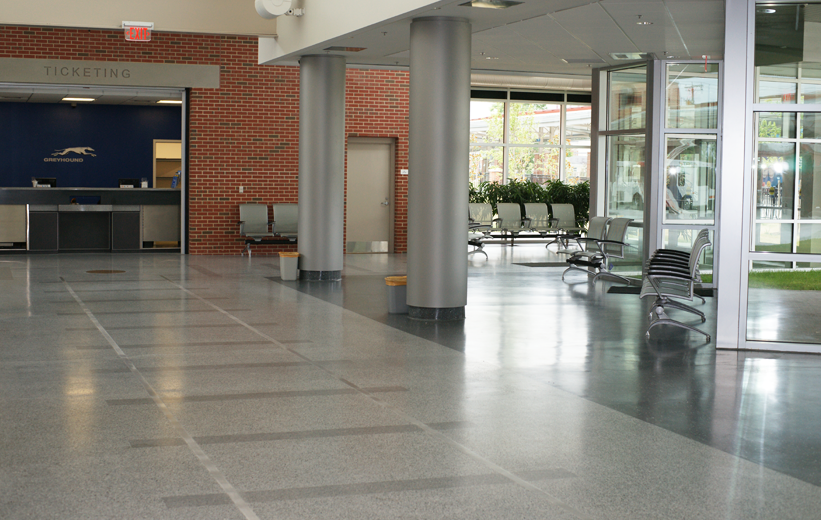 Grey terrazzo floors with traintrack graphic in waiting area of Petersburg Transit Center