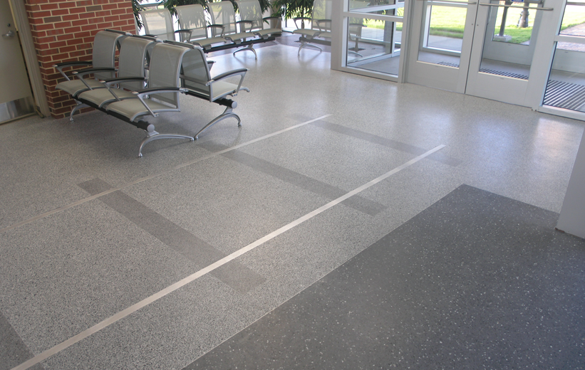 Gray terrazzo flooring in waiting lounge of St. Petersburg Multi-Modal Transit Center