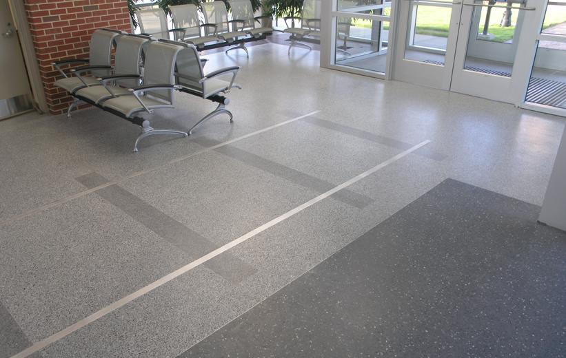 Gray terrazzo flooring in waiting lounge of St. Petersburg Multi-Modal Transit Center