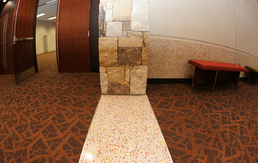 Recycled glass terrazzo flooring, carpet, and stone walls