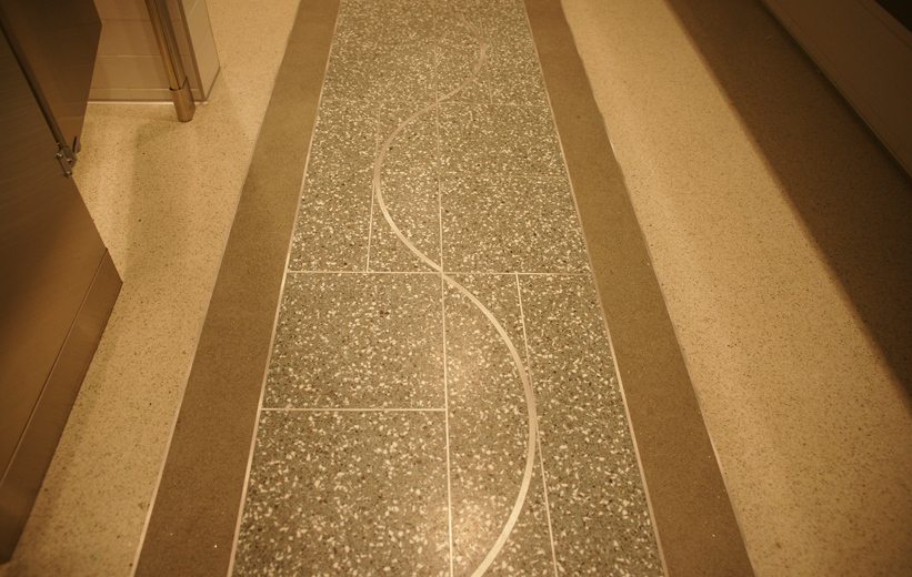 Cool terrazzo design installed at St. Jude Children's Research Hospital restroom using aluminum divider strips