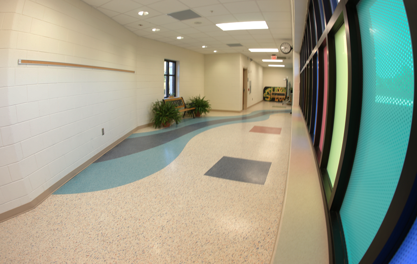 Terrazzo Flooring at T. Harry Garrett Elementary, with free-flowing lines and recycled glass aggregates