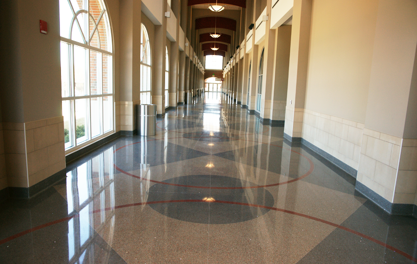 Circular terrazzo pattern in the corridor of Troy University Multisports Complex