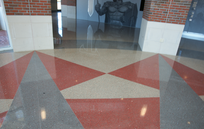 Grey and Red epoxy terrazzo design at Troy University Multisports Complex