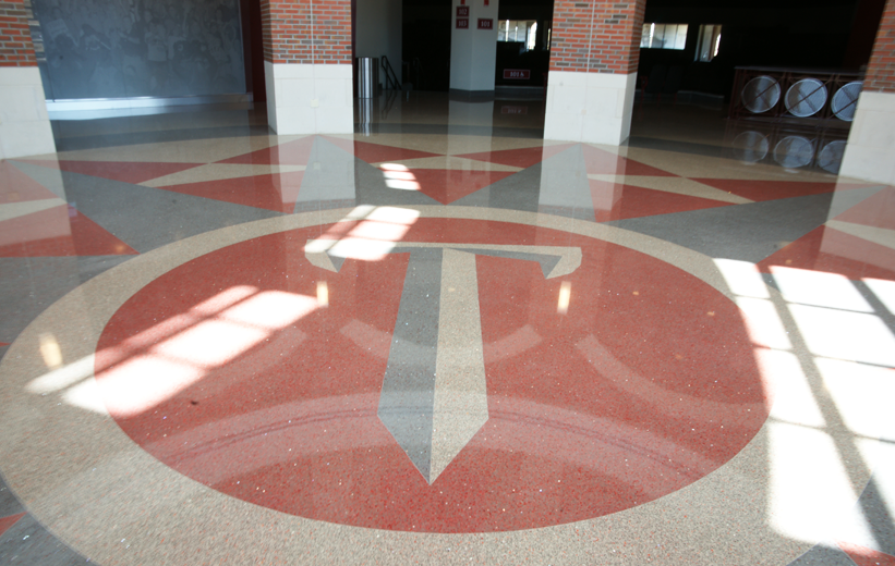 Terrazzo sword logo design in the center of the Troy University Multisports Complex
