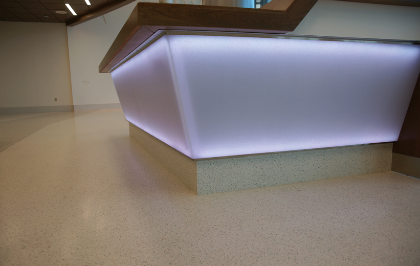 Precast terrazzo base is foundation for receptionist desk at UF Health North