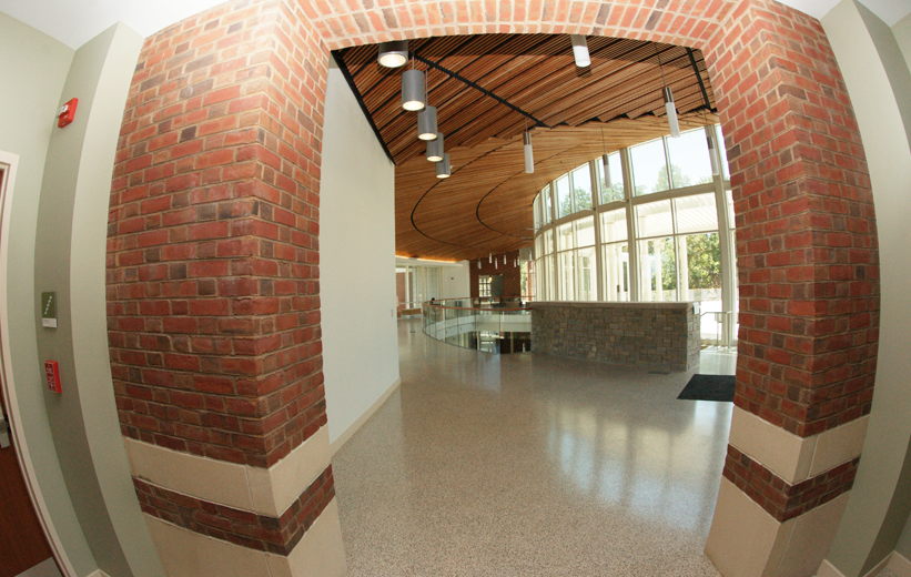 White terrazzo floors and brick wall interior at University of Virginia