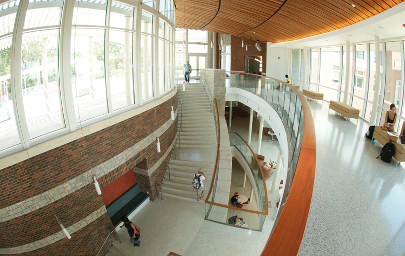 Students walking up the precast terrazzo treads and risers stairs at University of Virginia