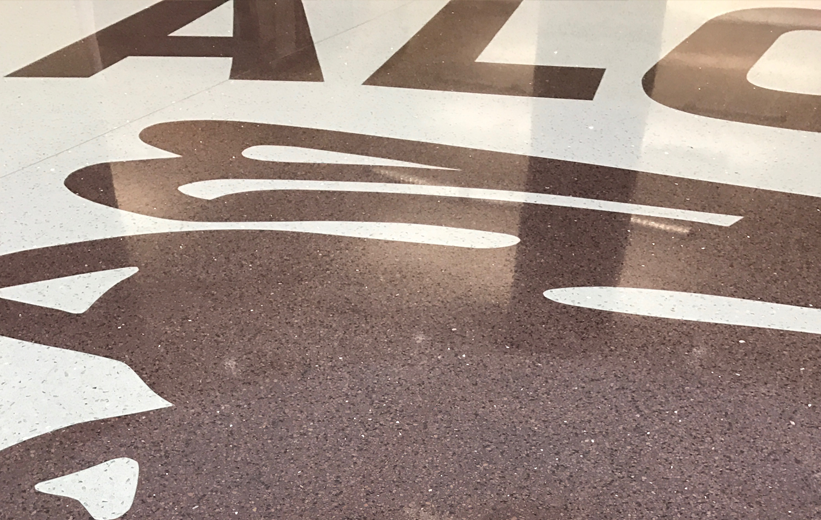 Close-up on terrazzo logo at Alcoa High School