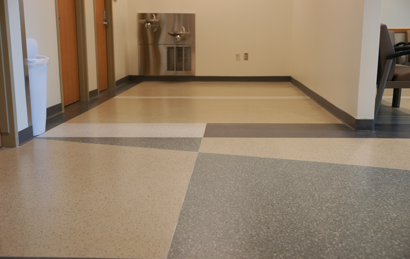 Terrazzo flooring near restroom at Halifax Deltona Health