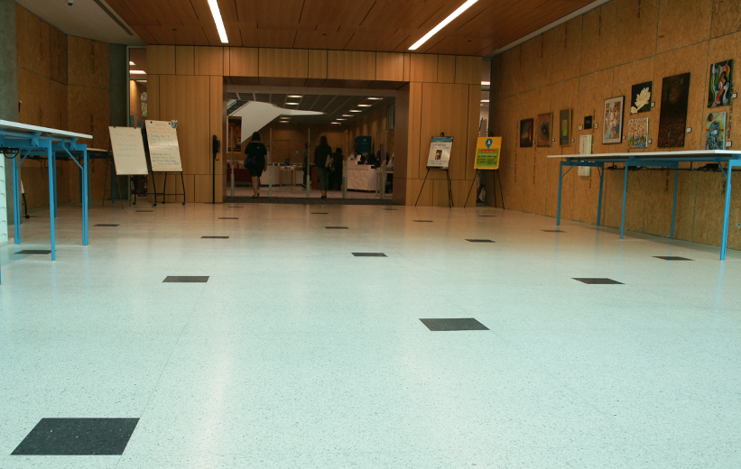 White terrazzo floors with black accent squares at Richland County Main Library