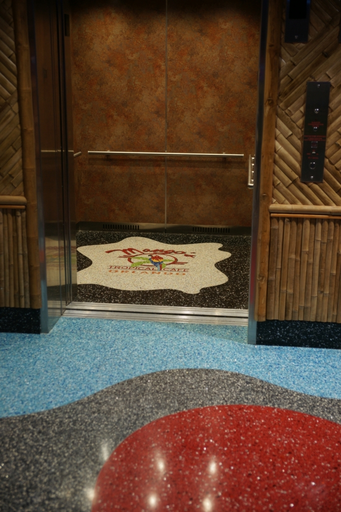 Mango's Tropical Cafe terrazzo logo installed in elevator