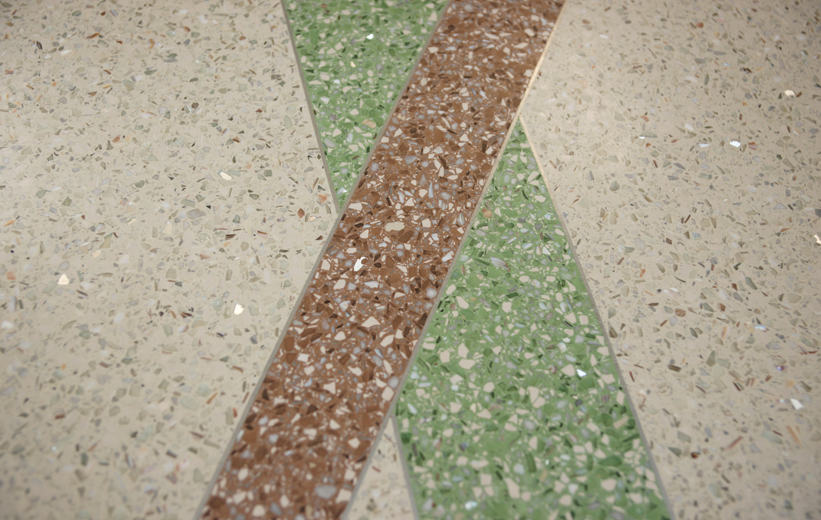 Epoxy terrazzo flooring installation at Jennie Moore Elementary School