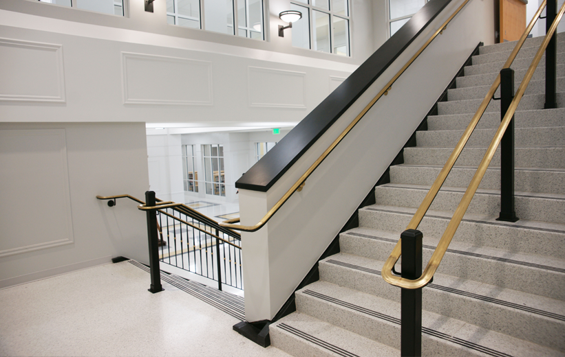 White Terrazzo Stairs with Brass Railing