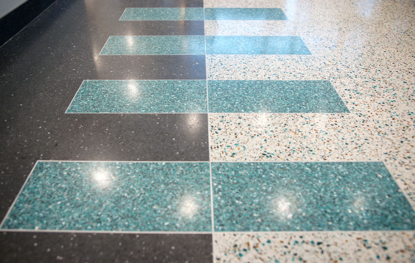 Teal terrazzo floor design at Coastal Carolina University