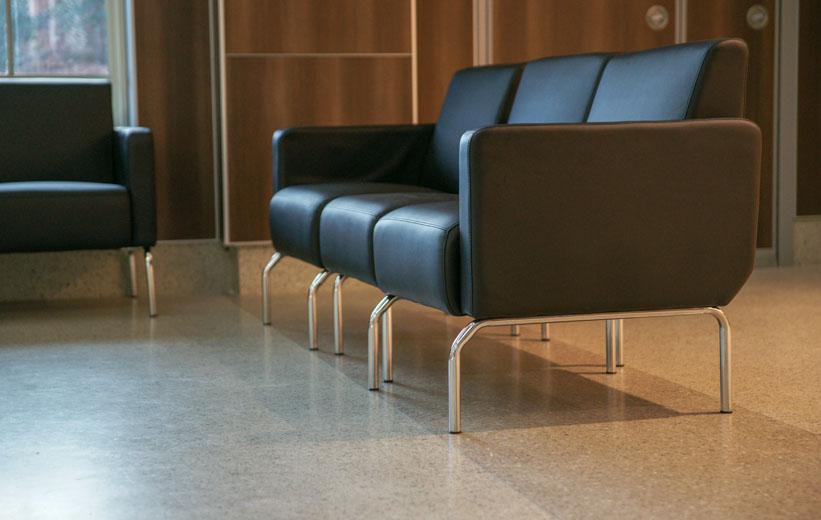 Brown Sofa on top of terrazzo floors