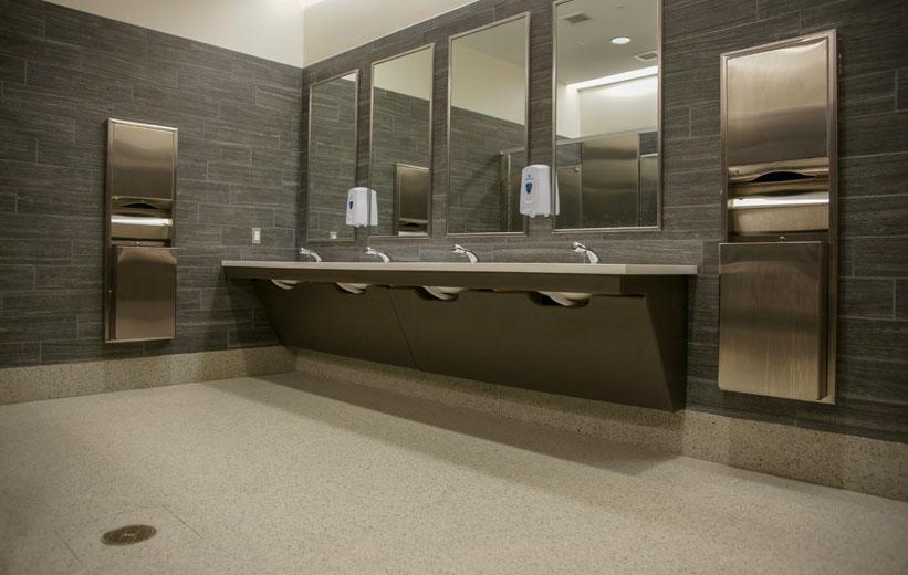 Clean terrazzo flooring inside bathroom area at Garrison School of the Arts