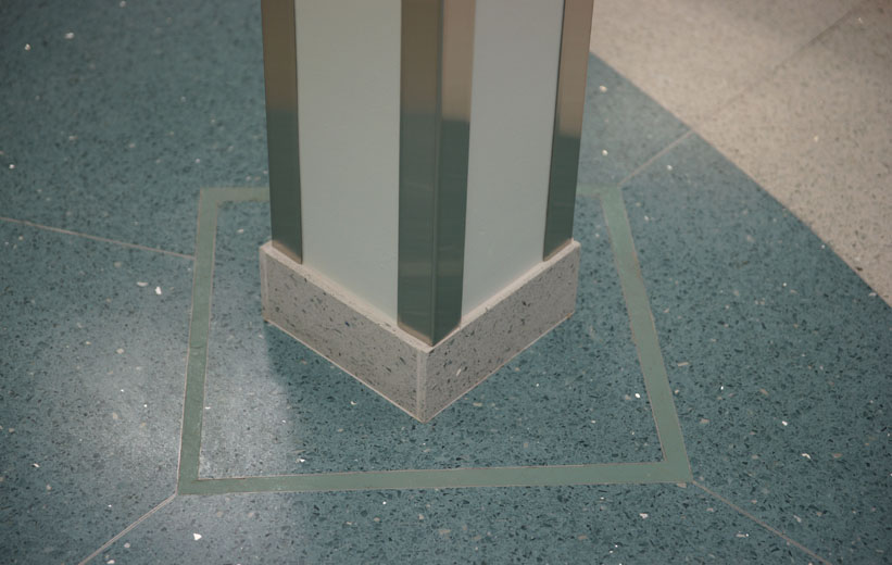 Green epoxy terrazzo floors and white terrazzo wall base